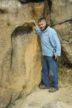 """The infamous giant """"Footprint of God"""" in South Africa. It is approximately 5' tall, and it's embedded in granite! Went and saw Michael Tellinger speak - one of the most fascinating lectures I've witnessed."""