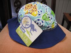 Hat for Active Toddlers Blue Starfish  100% Cotton, UPF 50+, 1-3 Years Old Protect your kids delicate skin with one of our stylish but functional hats. 10 Dundas St, Napanee, Ontario  Come on in and check us out! emmamayshattitude@gmail.com