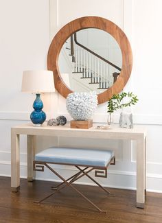 Parson console table with round wood framed mirror.