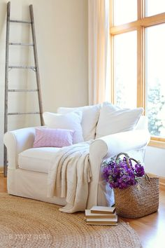 I need a chair like that! so inviting. Plus the pop of purple is to die for!