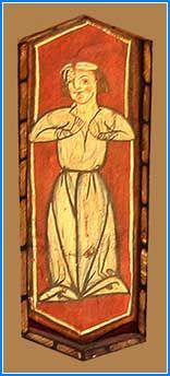 A continuación una mujer de corta talla y cabeza grande se presenta en una postura un tanto extraña. Vestida con una larga túnica, parece intentar abrírsela con ambas manos a la altura de los pechos. Este gesto se asemeja al de los judíos al rasgarse las vestiduras en señal de escándalo. Se le ha relacionado con la lascivia. De todas maneras, esta mujer es muy poco expresiva, y podría suponerse que simplemente se limita a colocar las manos sobre la tela.