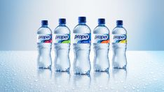 New #plastic #packaging for Propel Water: The flavored water is clear, and a small band of coordinating colors helps differentiate each flavor.