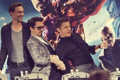 Tom Hiddleston, Robert Downey Jr., and Jeremy Renner <-- lol they're holding arms