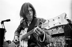 Neil Young, San Diego, CA, 1969  © HENRY DILTZ, 1969  Neil Young, White Falcon, Balboa Stadium, San Diego, CSNY outdoor concert, 1969