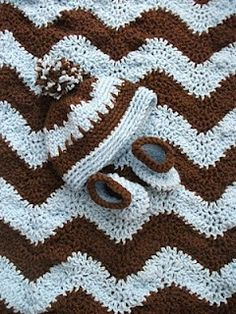 "Original pinner said, ""Crochet baby afghan / hat / shoes, links to free patterns for afghan & hat (shoe pattern not free): LOVE these striking colors & would also be cool gift for man, making it man-size, of course :)"" #free #pattern #crochet"