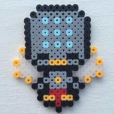 Welcome to the Pixelated Overwatch Spotlight, featuring Zenyatta. #zenyatta #overwatch #artsandcrafts #perlerbeads #pixelart #crafts #art #artfido #arts