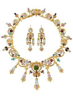 An antique gold and gem-set demi paruer, Paris, circa 1830. Comprising a necklace and a pair of earrings, set with aquamarines, pink topazes, turquoises, emeralds, garnets, pearls, rubies and opals. Stamped with the ram's head mark for Paris (1819-1838) #antique