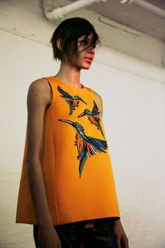 Orange sleeveless shift top with hummingbird print at Giles AW14 LFW.: