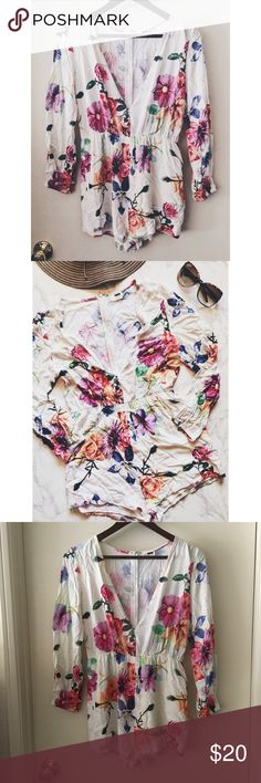 Floral Romper This romper is so cute! It needs to be steamed before worn. White/Off-White. Slightly faded. Not in new condition, but still in good condition. No modeling. 0904176.  ✅Reasonable offers welcome! (**I usually don't counter-offer, so please make your highest offer 😊) ✅BUNDLE DISCOUNTS! 🚫No trades/paypal/other apps. Rumor Boutique Pants Jumpsuits & Rompers