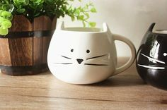 Cats and coffee... the two most important things in life. We've combined the two in this gorgeous novelty kitten coffee mug that any cat lover is sure to adore.