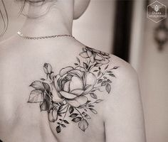 Black and White Rose Tattoo on Back Shoulder.