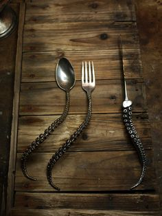 SEA-LIFE DINING SET - 240.00 - Take your dining experience under the sea with this dining set designed to add a sense whimsy to the table. Silver plated with antiqued silver handles, the fork, spoon and knife bear a tentacle motif brought to fruition by artist Perry Gargano.