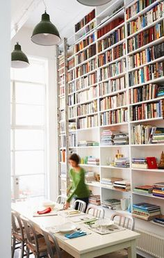 Op de whishlist: plafondhoge boekenkast met bibliotheekladder