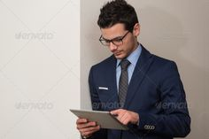 Businessman On A Break With His Touchpad ...  Expressing, adult, bank, banking, beard man, business, businessman, casual, caucasian, cell, ceo, close-up, computer, confidence, confident, corporate, employee, executive, fashionable, glasses, handsome, indoor, internet, job, lawyer, looking, male, man, manager, modern, occupation, office, online, only, owner, people, person, phone, portrait, professional, standing, successful, suit, telephone, text, well dressed, work, worker, young
