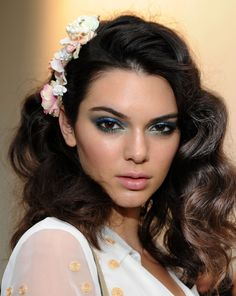 Models including Kendall Jenner (pictured) rocked 'The Diane' 'do, inspired by how the designer herself wore her curly hair in the 70s. Hairstylist Orlando Pita was behind the look, creating rows of buns in the models' hair to form curls when unraveled (get the how-to here!). To complete the Studio 54-inspired look, renowned makeup artist Pat MgGrath applied aquamarine eye shadow around the eyelids; upper and lower lash lines, then plenty of black mascara.   - Cosmopolitan.co.uk