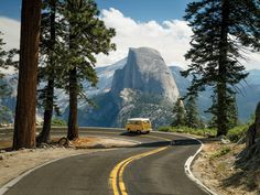 VW Camper Driving with a Beautiful View of Half Dome Yosemite National Park California. [2048x1536]  Chris Burkard