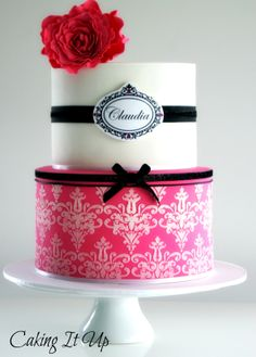 Gorgeous Pretty In Pink two tier cake with stenciling and large sugar flower www.facebook.com/cakingitup