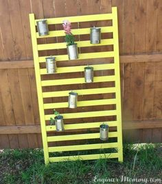 She leans an old crib rail against a trash can. What it becomes? I am so saving this backyard idea for spring!