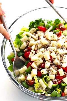 This unforgettable Italian chopped salad is made with lots of tomatoes fresh basil Pecorino cheese Romaine lettuce balsamic drizzle. And a surprise topping -- everything bagel seasoning! Italian Sub Salad Recipe, Italian Chopped Salad, Italian Salad, Italian Soup, Italian Dishes, Italian Recipes, Types Of Sandwiches, Pasta Types, Chopped Salad Recipes