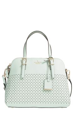 Delicate perforations lend a sweet eyelet-inspired look to this Kate Spade satchel in a soft mint color that is perfect for carrying the essentials.