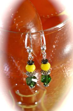 Emerald helix crystals yellow rondelle by aimeeNandysEarrings, $10.00