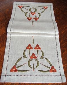 The Spiderwort Table Scarf is worked in pearl cotton thread on Natural Irish Linen (with white flowers) or Pasadena Flax (with russet flowers) using...