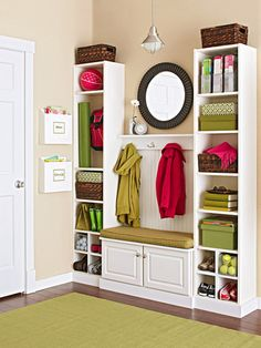 If only I had a place to put this! DIY entryway storage; Join tower-style bookcases to mimic the look of custom built-ins. Set a wall cabinet on the floor as a seat and connect the towers with a shelf and wall-mount hooks. Install file bins to sort incoming and outgoing mail and hang a mirror for a quick primp before heading out the door - I WANT this in a house someday!!