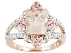 This Rose Gold, Morganite, Pink Sapphire, and diamond ring is pretty in pink.
