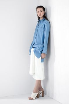 Washed silk dress (worn as a shirt) with Martel's sweater (worn as a skirt) in Fall's Shirt Tales trend.
