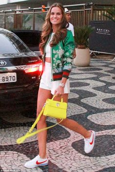 A winning look! Brazilian model Izabel Goulart donned a stylish, jade green varsity-inspired jacket and white Nike trainers as she headed out of her hotel in Rio de Janeiro on Sunday Izabel Goulart, Model Street Style, Street Style Looks, Nike Outfits, Summer Outfits, Summer Clothes, Zapatillas Nike Cortez, Stan Smith Outfit, Look Fashion