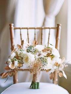 gold + white bouquet with Patience garden roses, white Majolika spray roses, gold Queen Anne's Lace, gold seeded eucalyptus, white lisianthus, and succulents | Landon Jacob #wedding
