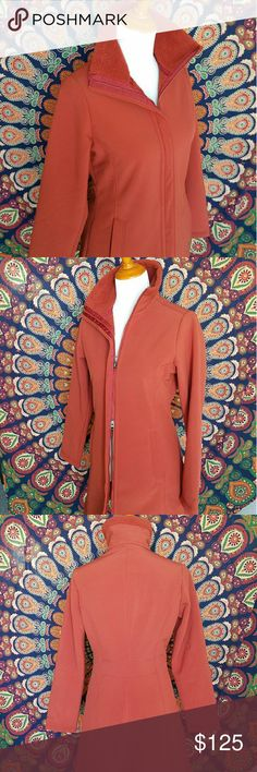 """Sleek Pumpkin Spice Parka 'AU Train' Coat Sleek, windproof fleece soft-shell coat made of Polartec Windbloc polyester. This coat has a high pile fleece interior and woven exterior with Princess seaming in front and back for a contoured fit. 2-way zipper front with outer wind flap and zip-through stand-up collar, hand warmer pockets on the front seams.  MEASUREMENTS - Shoulder to Shoulder 14"""", Chest: 38"""", Waist 32"""", Length 33"""", Sleeve length 25"""". MATERIAL - 94% Polyester, 6% Spandex Patagonia…"""