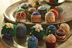 Pincushions made of plastic bottle caps.