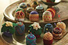 bottle cap pin cushions. favorite!!!
