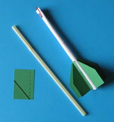Build a paper rocket and send it flying with a single puff of air. Discover how various fins can change how your rocket will fly...  Rocket is made by wrapping paper around a pencil, taping it, removing the pencil, and adding paper fins.  The launcher is a straw that you blow through.