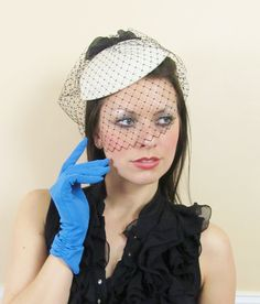 Vintage 1950's White & Black Birdcage Veiled Hat /// Fascinator. $68.00, via Etsy.