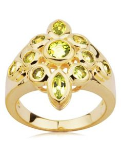 Infuse your look with vibrant color without sacrificing style. This gorgeous gold over sterling silver tapered band ring is elegantly embellished with marquise and round-cut peridot. #jewelry #ring #joolwe