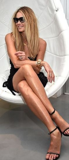 Who made  Elle Macpherson's black sandals and strapless fringe dress?