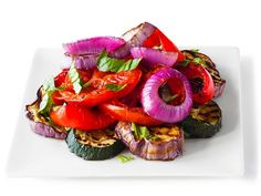 Ellie's Grilled Ratatouille Salad : Whip up this lightly charred salad of fresh red bell pepper, zucchini, tomatoes and eggplant on the grill in no time.