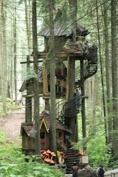 The Enchanted Forest, a family attraction built in an old growth British Columbia forest, features fairytale characters, a dragon-guarded castle, and this three-tier treehouse rising 50 feet into the air. | Photo: Wayne Krauscopf | thisoldhouse.com by christine.brzycki