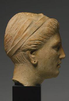 An Etruscan Terracotta Portrait Head of a Woman, Circa 3rd/2nd Century B.C.: