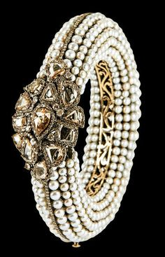 champagne diamonds cluster and pearl bangle