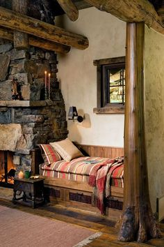 Love small book nooks? Check out this cozy reading nook tucked in next to a fireplace and beneath a window.