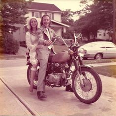 The newlyweds pose on a brother's Honda motorcycle for a photo on their special day. (Source: Reddit)