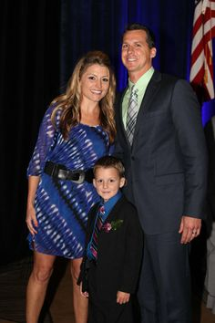 Ryland with his parents Hillary and Jeff, being honored in San Diego. Photo: Cali Griebel/photosbycali.com
