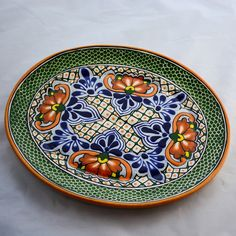This large platter is a feast for the eyes, and itÍs large enough to hold whatever you might be serving for your own feast. The hand painted and hand crafted platter from Talavera features the stunnin