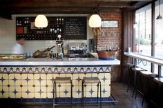 Traditional tiled bar gives a great retro feel along with old accessories