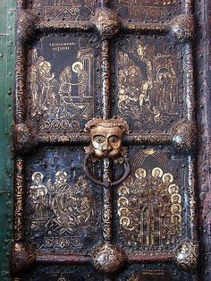 Russian Golden Doors, Cathedral of the Nativity, Suzdal, Russia.  Numerous religious scenes carved into brass on huge doors of the Cathedral in Russia.