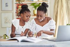 Two young sisters sit together in the living room at home and do their home work Homework, Sisters, The Unit, Stock Photos, Living Room, Learning, Studying, Home Living Room, Teaching