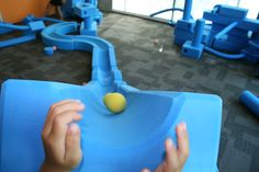 A child's perspective of their creation.  We love to see the sense of achievement on the children's faces after putting their thoughts into reality. On top of that, they are physically learning structures, cause & effect, momentum... all through PLAY!